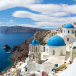 36322887 - panoramic view of the oia village under puffy clouds, santorini island, greece