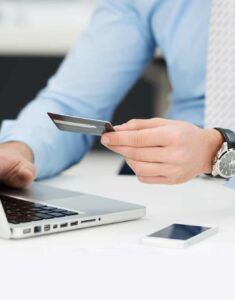 businessman-holding-credit-card-shopping-online