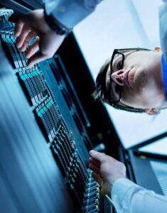 man operating server IT hardware