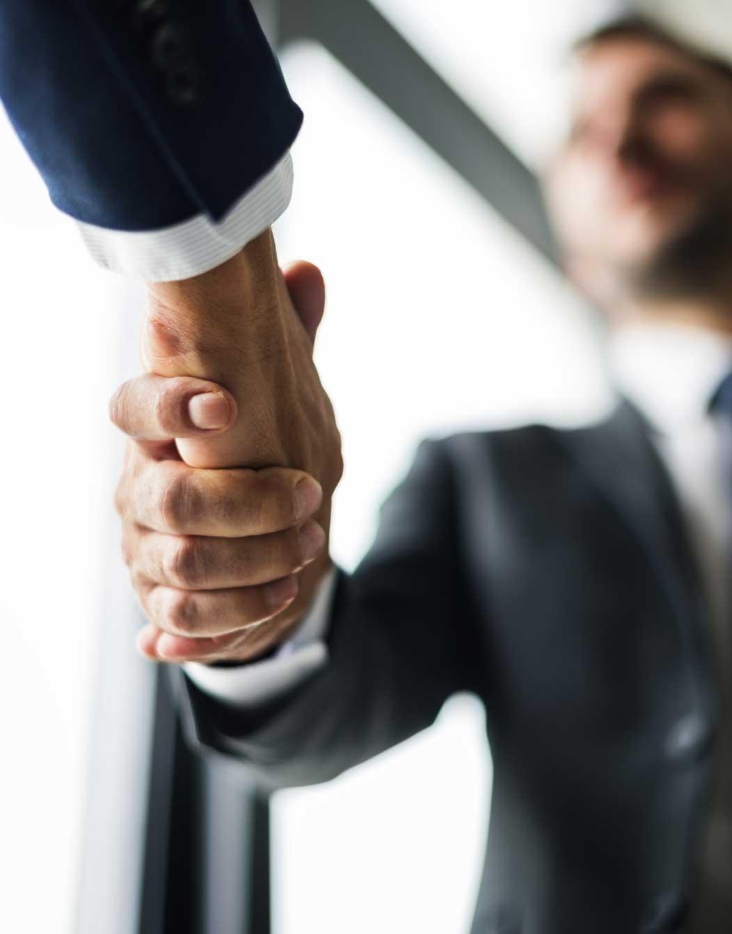 business men shaking hands in partnership