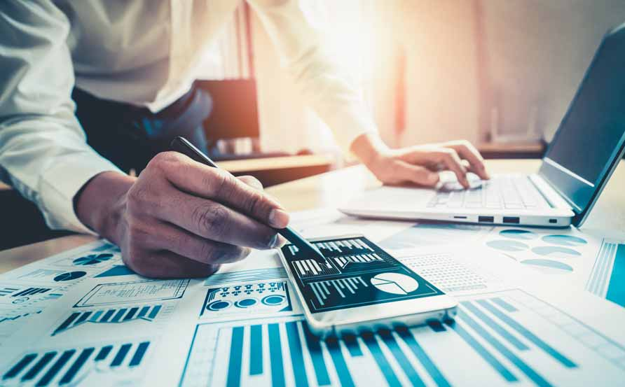 businessman looking at spend analytics can improve your procurement