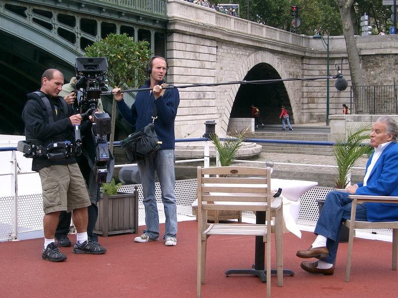 Film crew with sound man holding boom mic