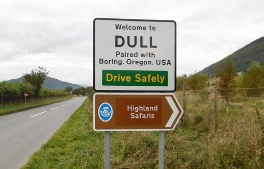 Road sign showing the way to a place called Dull