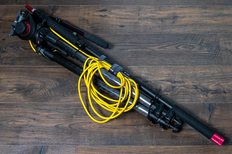 Video tripod and microphone boom pole bungeed together