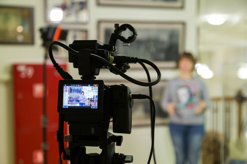 A teacher being filmed for a school marketing video