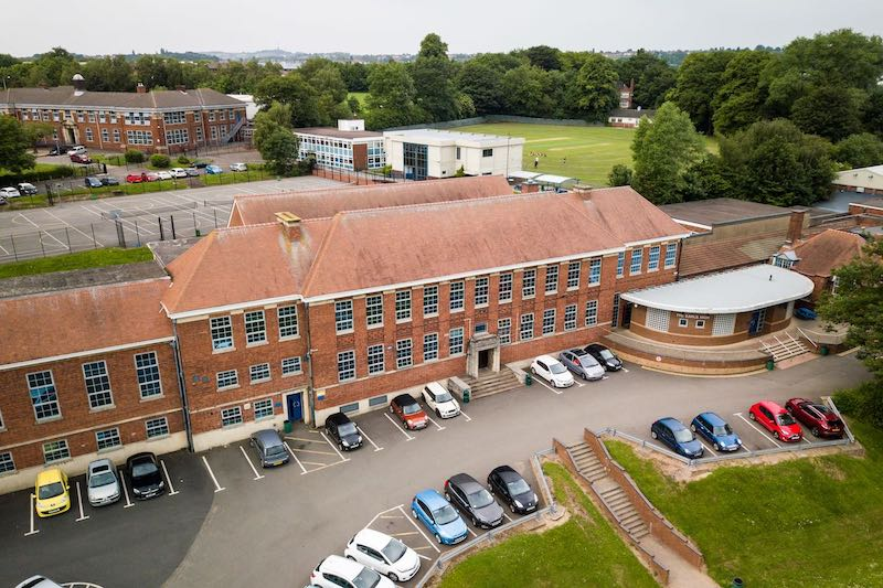 School promotional photography example of an aerial shot of imposing school buildings.