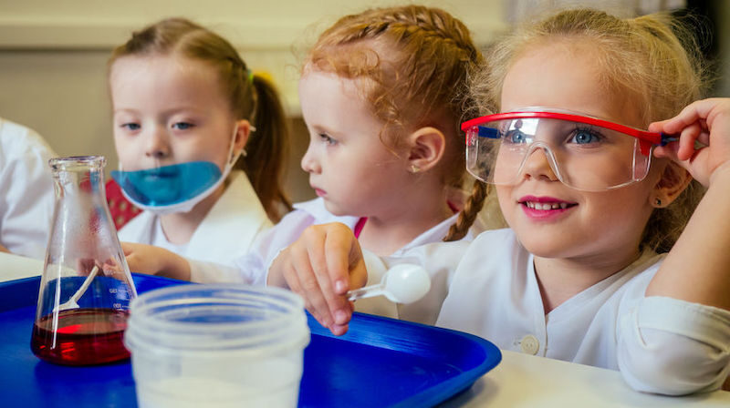 School children doing a science lesson used for school promotional video