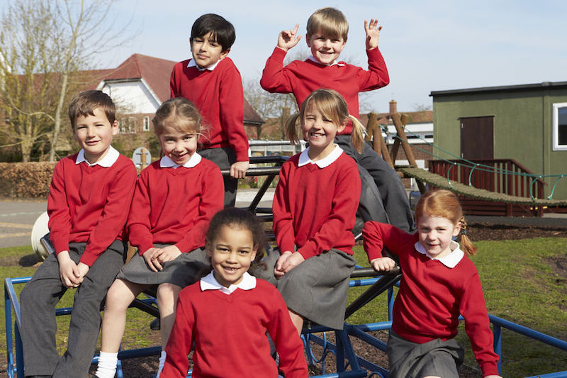 School promotional photography example of group shot outside with students in uniform