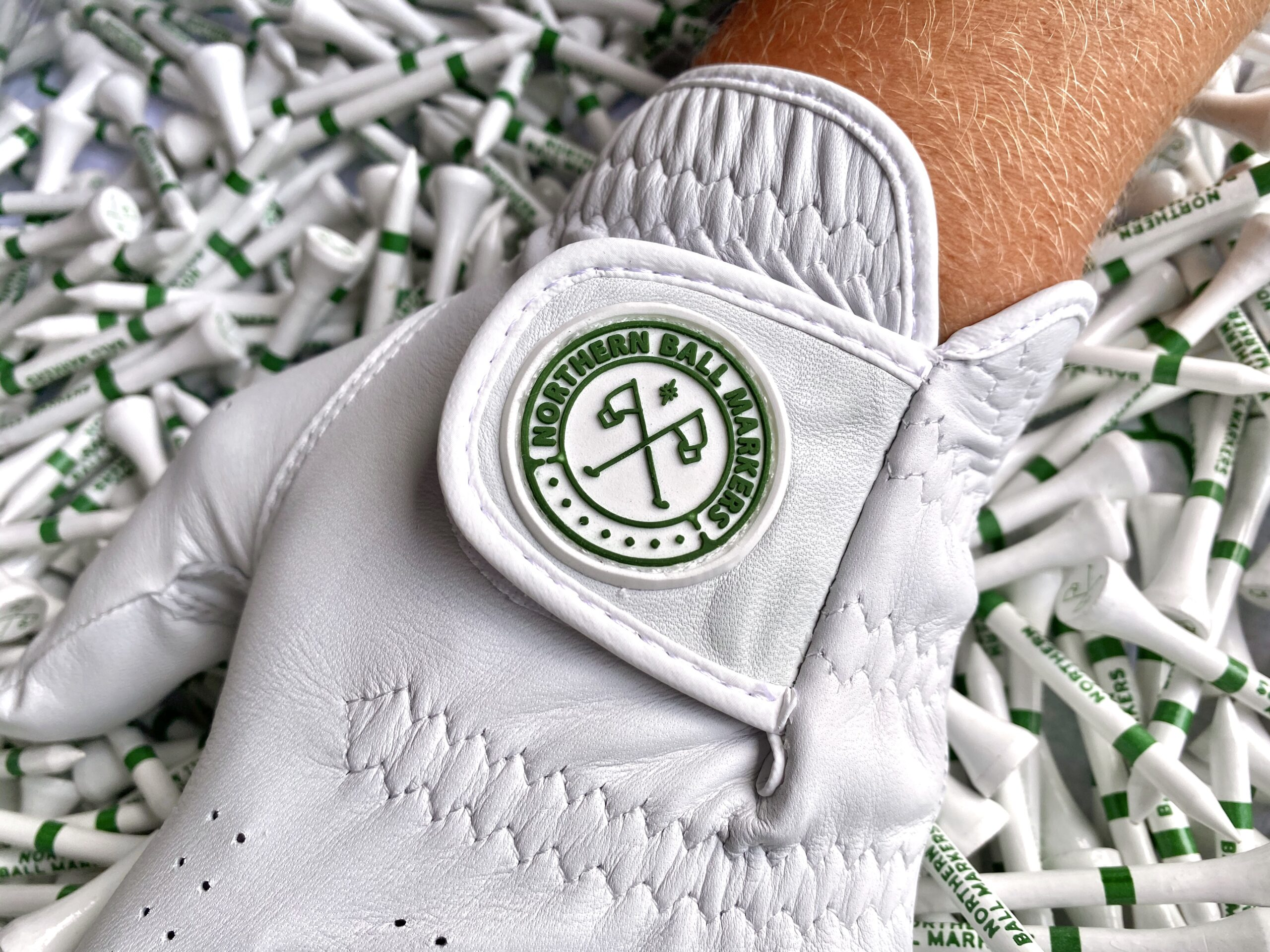 Northern Ball Markers golf glove design in white with green emblem
