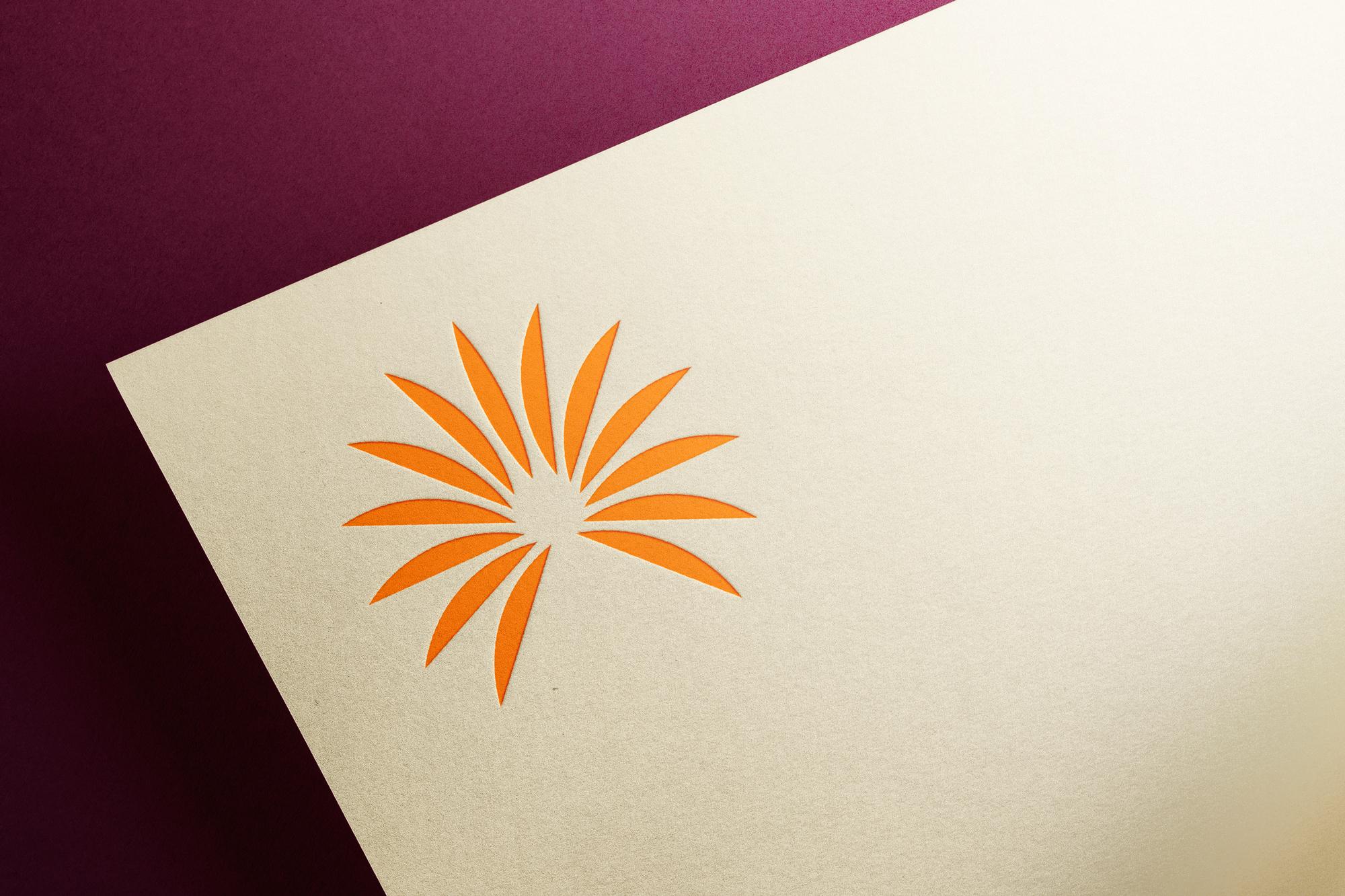 Hampton Brown logo symbol printed in orange on light paper