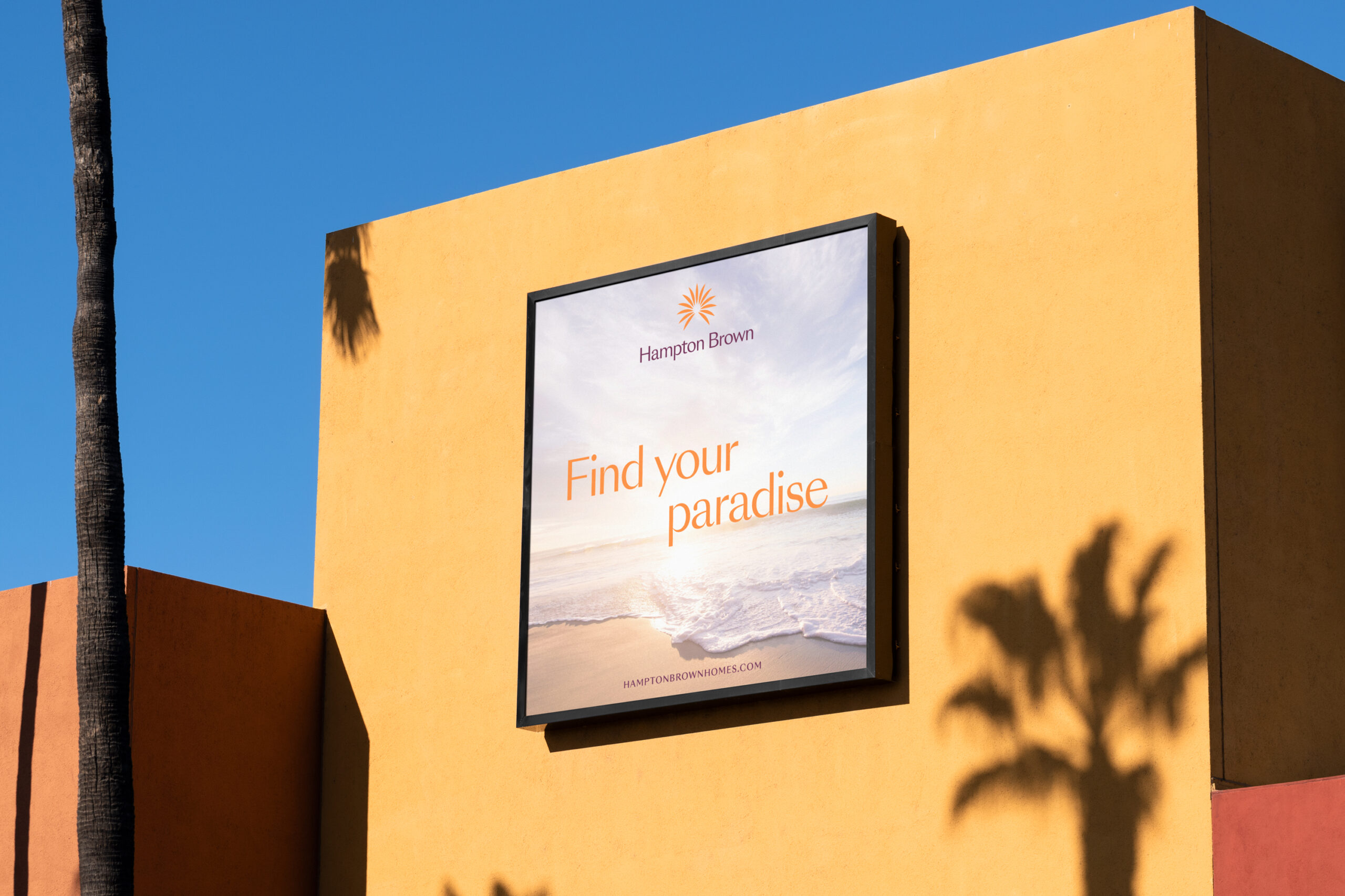 Hampton Brown billboard ad on side of building in sunny city