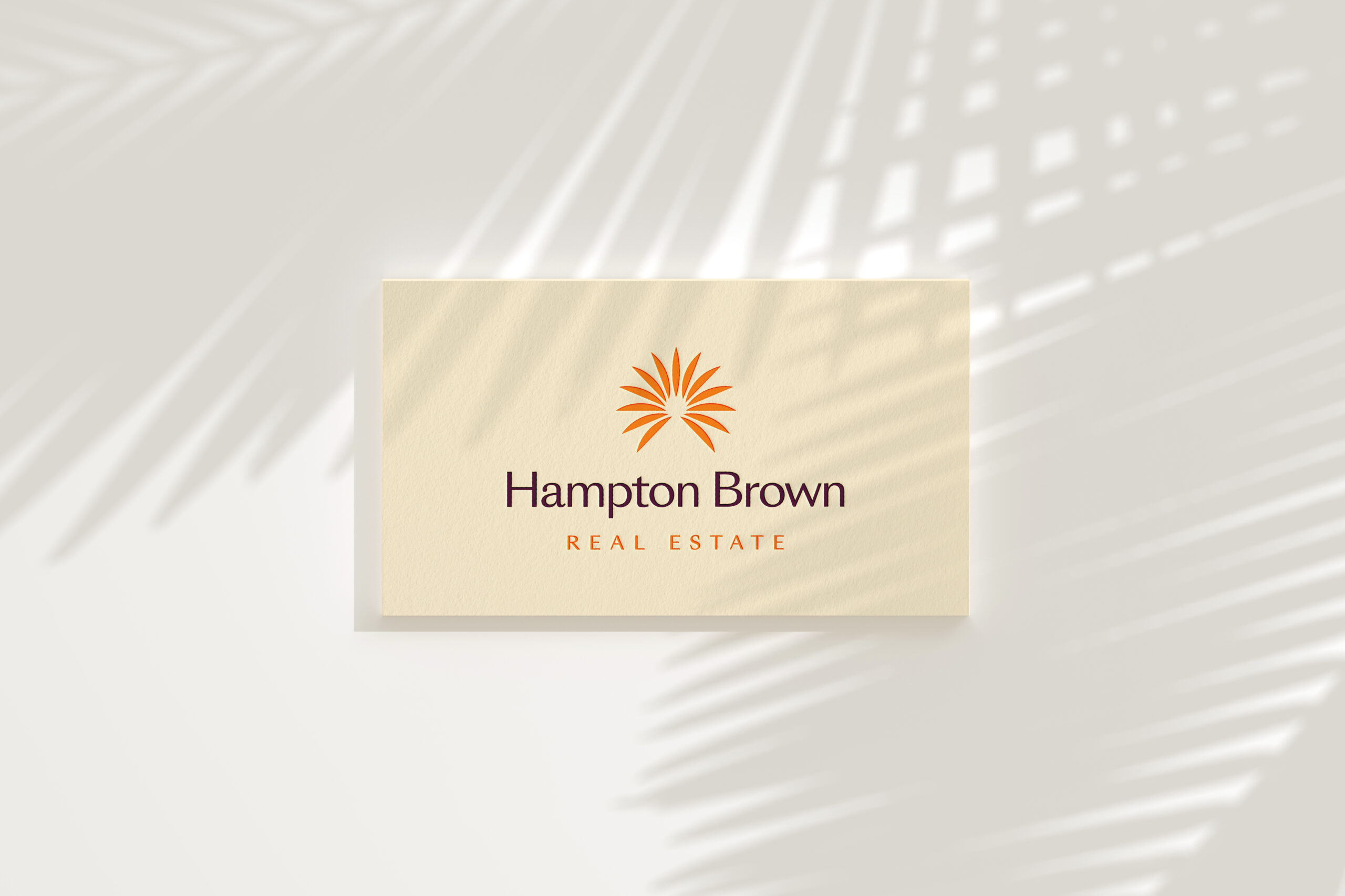 Hampton Brown printed business cards with shadows of palm trees falling across