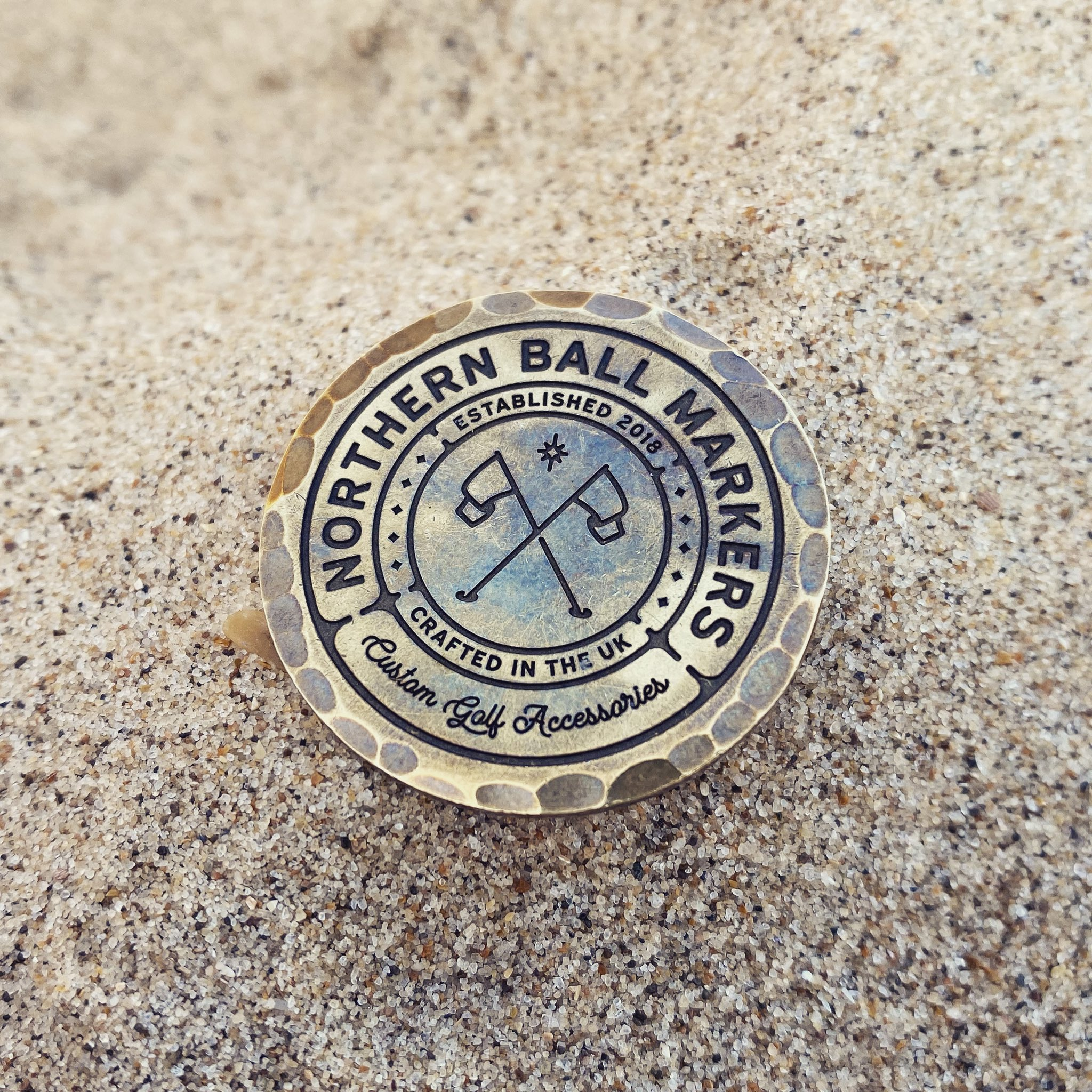 Northern Ball Markers logo as a custom engraved marker