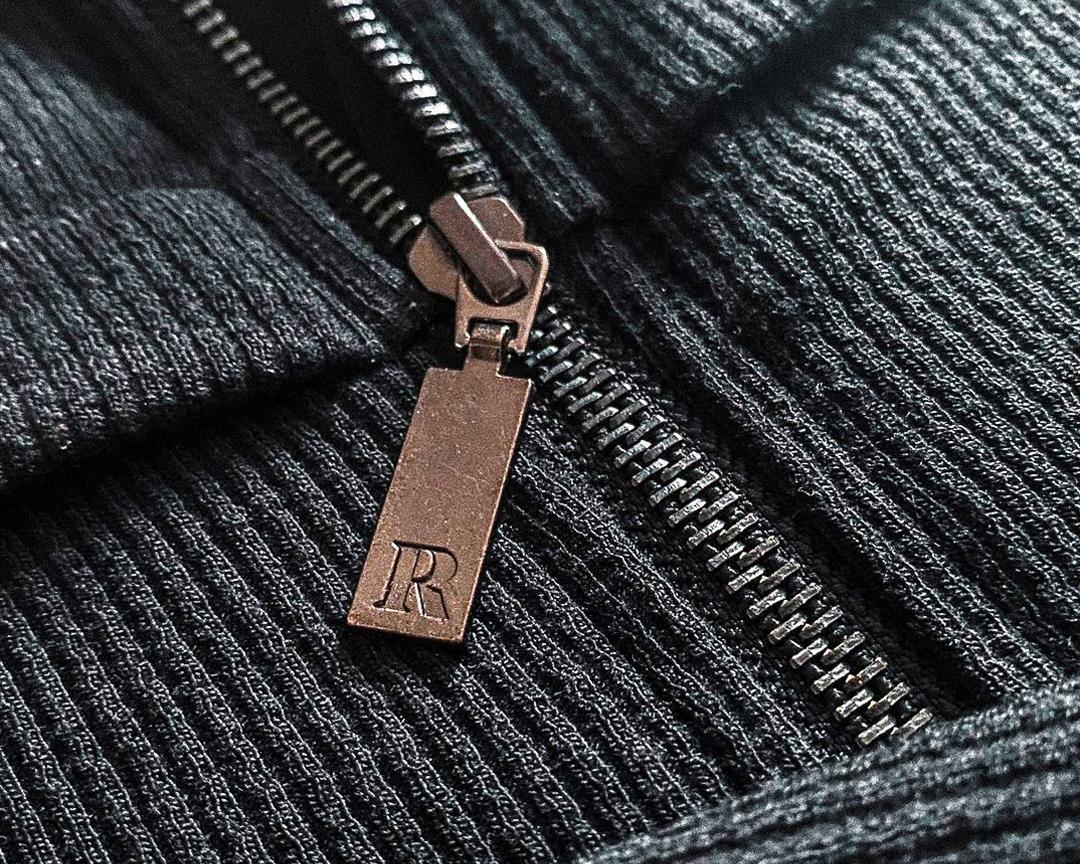 Resolve Clothing symbol embossed into zip