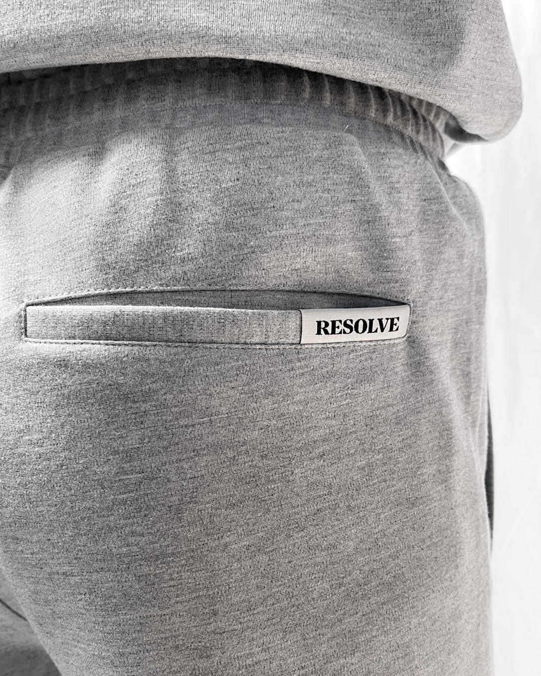 Resolve Clothing logo tag on grey casual joggers