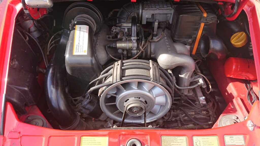 911 engine bay before clean up