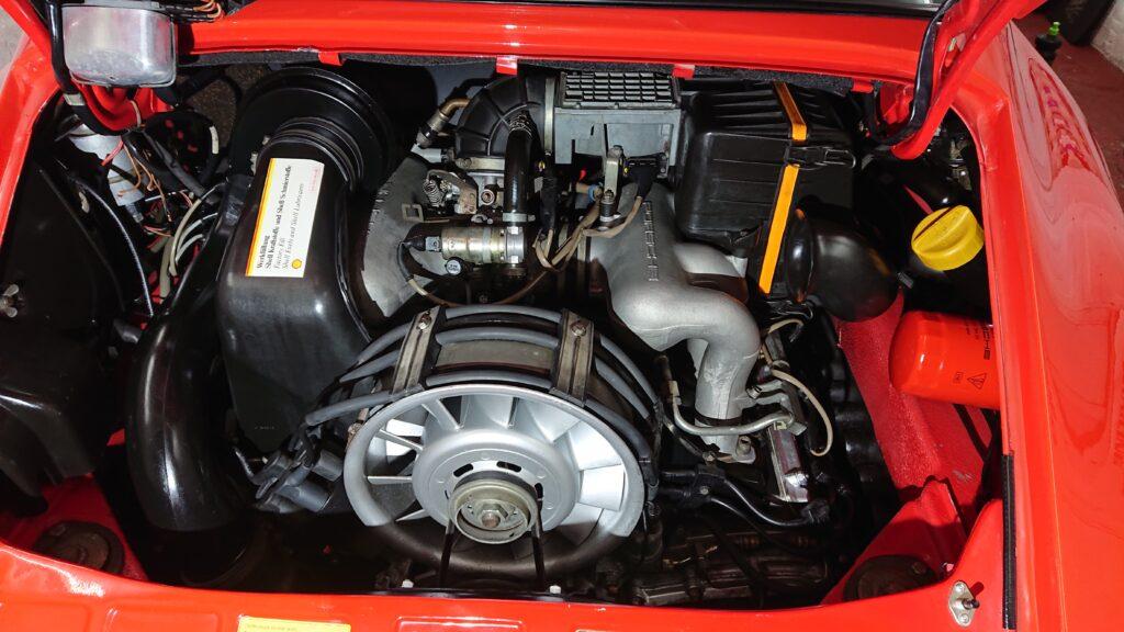 32 year old Porsche 911 engine bay detail