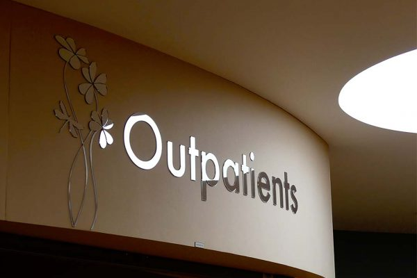outpatients mirror signage and wall art