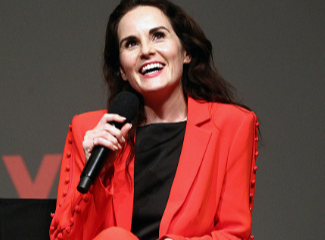 Michelle Dockery attends Netflix Celebrates event in August in dashing red suit