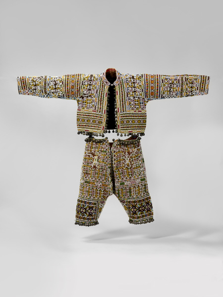 Trouser and jacket, Philippines, decorated glass beads and embroidered with bells at the waist and bottom. Musée du quai Branly