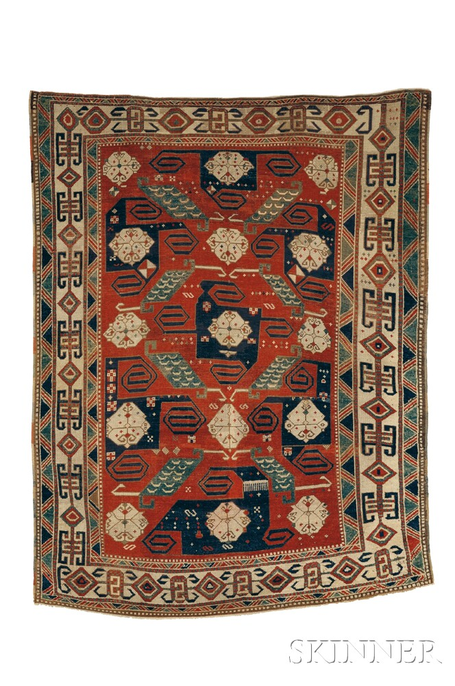 Pinwheel Kazak rug, southwest Caucasus, mid-19th century, (even wear, areas of repiling, minor reweaves on both ends and both edges, re-overcast), 7 ft. 2 in. x 5 ft. 7 in. Lot 129, estimate $15,000-20,000