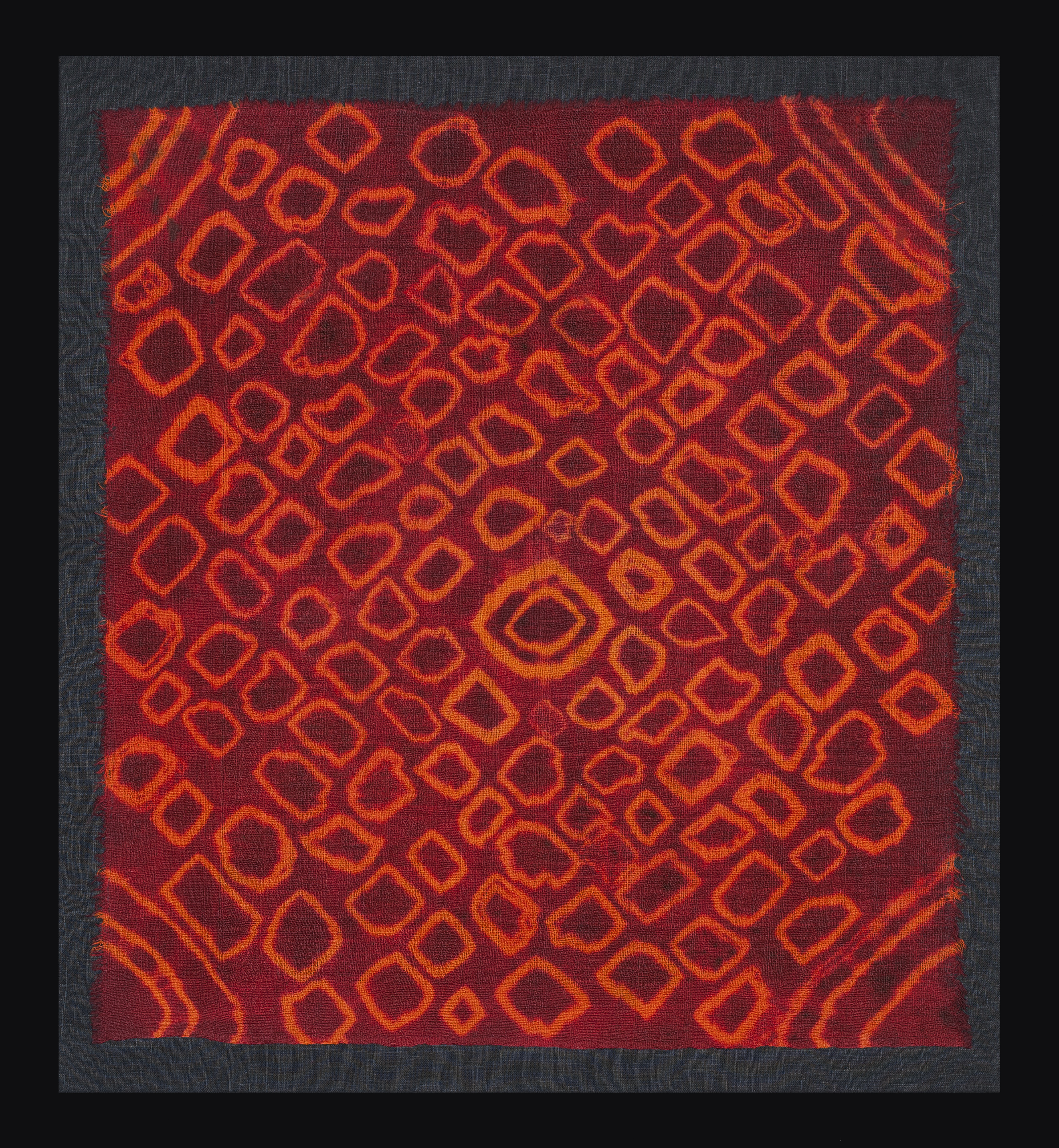 Woman's ceremonial head scarf, aganoun, Ait Haddidou tribe, High Atlas, Morocco, 1st half 20th century. Resist-dyed wool, 79 x74cm, mounted, Clive Loveless, London
