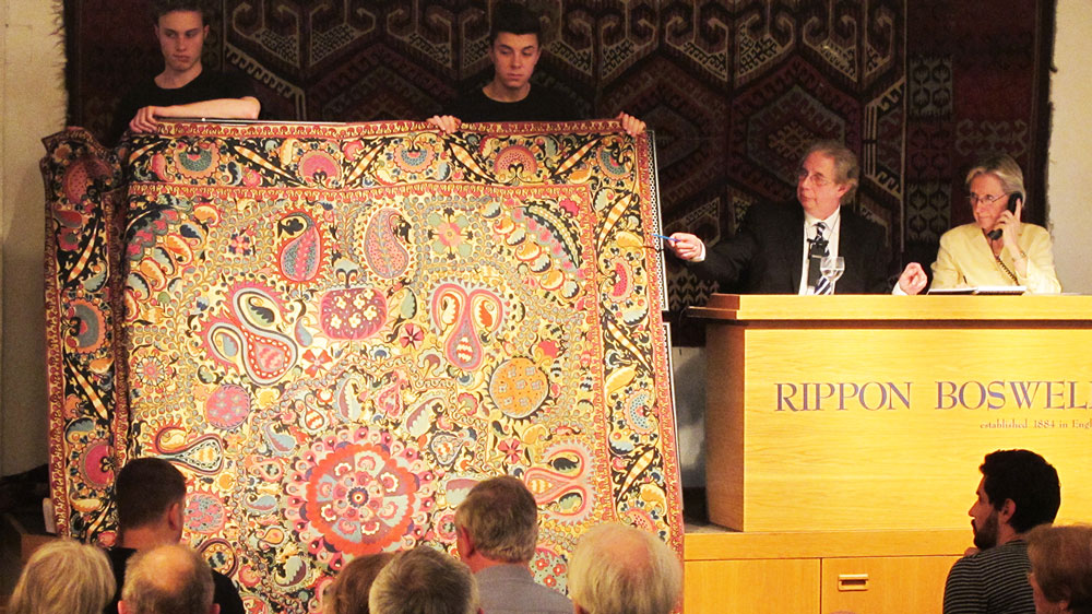 Auctioneer Detlef Maltzahn selling the record breaking suzani embroidery at Rippon Boswell in Wiesbaden, 25 May 2013