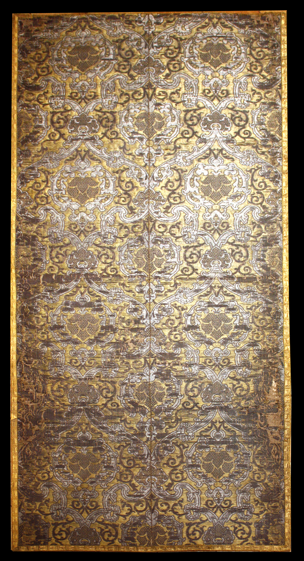 Italian Brocatelle, circa 1550, with a design of arabesques, entwining stems and vegetal ornament woven in silver metal thread and silk on a rich yellow silk ground. Joanna Booth, London