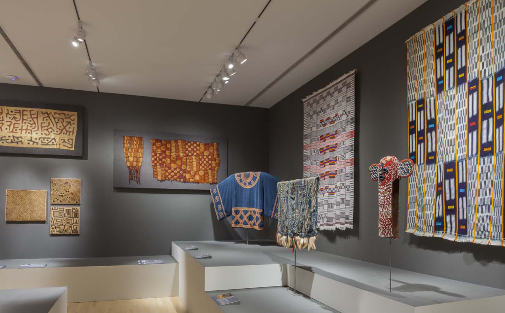 Gallery installation of 'Majestic African Textiles' at Indianapolis Museum of Art showing Central African raffia weaving, Dida plant fibre skirts and Yoruba beadwork