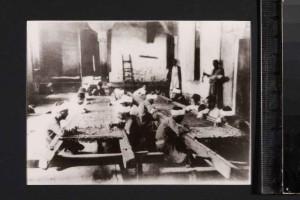 Photograph showing artisans at work at Dar al-Kiswah; 8.8 x 12 cm