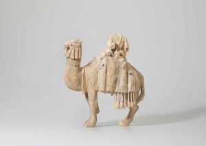 Statuette of a camel and rider Mesopotamia or the Levant, 8th or 9th century; ivory, carved, with some traces of black pigment, 25 x 23.5 x 12 cm
