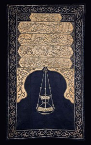 Sitarah for the minbar of the Meccan Sanctuary, with the name of King Faruq of Egypt Cairo, dated AH 1365 (1946 AD); dark-blue silk, with beige silk appliqués, embroidered in silver and silver-gilt wire over padding, 212 x 125 cm