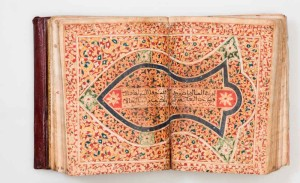 An extensively illuminated copy of the Dala'il al-khayrat of al-Jazuli and other prayers, including several pages with the names of Allah and Muhammad written in a large, decorative script, two diagrammatic drawings of al-hujrah al-sharifah and al-rawdah al-mutahharah at the Prophet's mosque in Medina, as well as a two-page illustration of the Prophet's sandal; Morocco, copied by Muhammad bin 'Abd al-Qadir al-Rabati, AH 1254 (1838 AD), 23 x 18 cm (page)