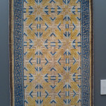 This carpet would have been used to cover the raised heated platform, the lang, upon which a scholar or important person would sit. The yellow dye would have be red when dyed originally but has since faded. Kang carpet, Ningxia, northwest China, ca. 1700.
