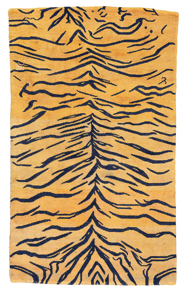 Lot 14 A TIGER RUG TIBET, LATE 19TH CENTURY 4ft.11in. x 2ft.10in. (150cm. x 86cm.) £3,000-5,000