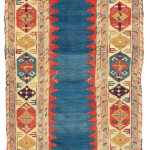 Lot 19 A DAGHESTAN RUNNER A NORTH EAST CAUCASUS, LATE 18TH CENTURY 8ft.6in. x 3ft.2in. (258cm. x 96cm.) £18,000-24,000