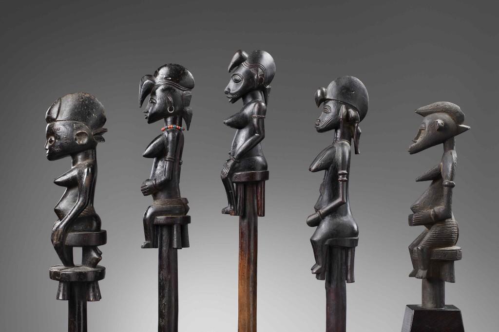 Bernard-de-Grunne,-African-Masters,-Serie-of-Senufo-ceremonial-staff-5.-Senufo-ceremonial-staff-Wood,-total-height--141,5-cm,-height-statue--35,2-cm,-Republic-of-Ivory-coast-