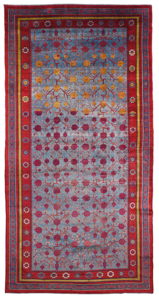 Lot 214, A silk Yarkand carpet, East Turkestan Estimate £20,000 — 30,000