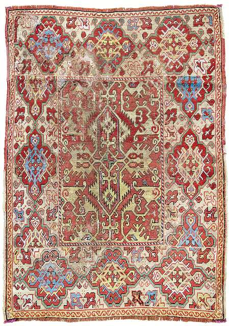 "An Ushak ""Lotto Carpet"" with a golden ground border in medallion design, West Anatolia, 17th century. 140 x 108 cm. Estimate €12,000"