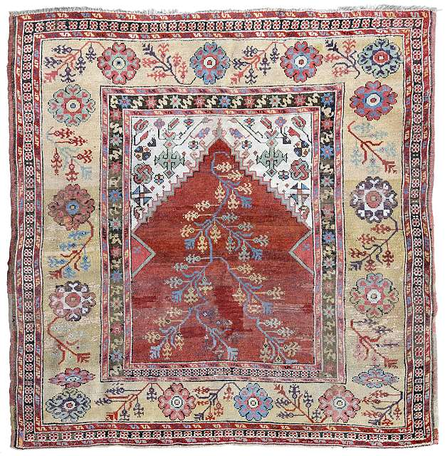 Lot 1. A Konya prayer rug with a yellow ground border, Central Anatolia, 18th century. 141 x 144 cm. Estimate €4,000