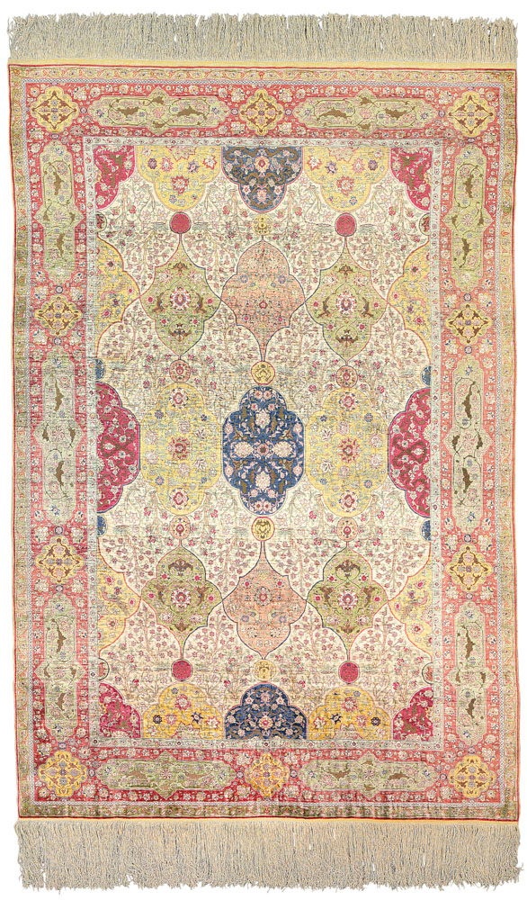 Lot 112. SILK AND METAL-THREAD KUM KAPI RUG SIGNED, ISTANBUL, TURKEY, CIRCA 1920 7ft.7in. x 5ft.1in. (229cm. x 153cm.) £30,000-50,000