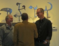 San Franscico tribal art dealer Robert Dowling (right) in front of Erik Farrow's Zairean throwing knives