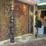 Gideon Hatch mixes rugs of his own design with antique rugs including a 19th century Heriz on his stand at HALI at Olympia