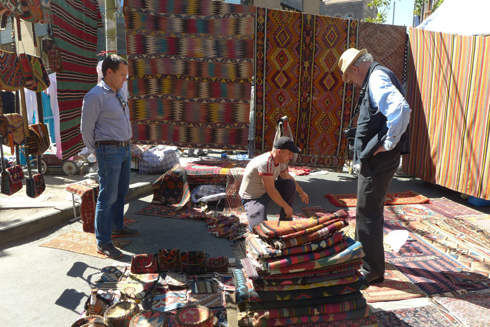 Ben Evans and Paul Ramsey look at rugs and fragments on offer in the Vernissage Market, Yerevan, Armenia
