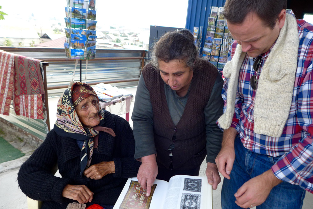 Ben Evans asks a lady selling handicrafts if any of the rugs shown in Oriental Rugs Vol 1 by Ian Bennett are familiar designs, Noradouz, Armenia
