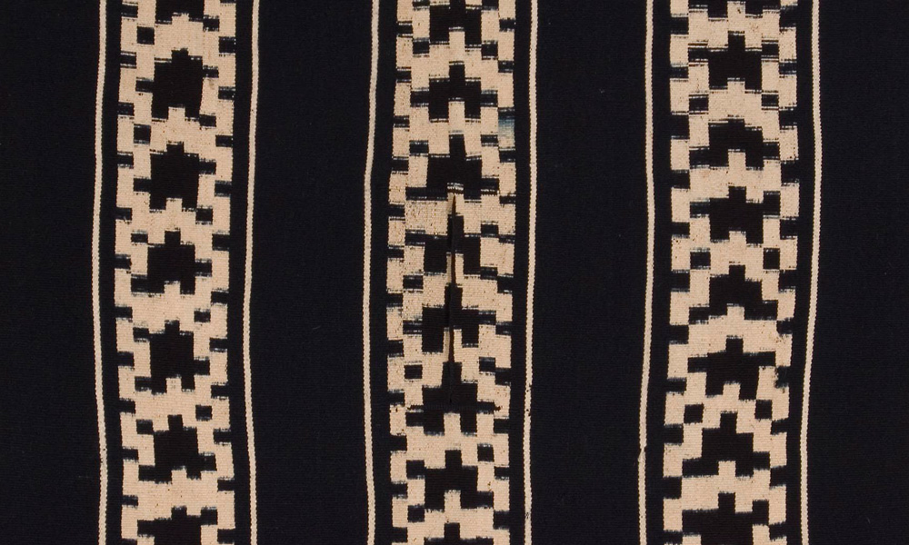 CHILE  Mapuche chief's poncho (detail), southern Chile, early 20th century. Wool, warp ikat, indigo-dyed. Andrés Moraga Textile Art, California. In the western hemisphere, the striking blue and white geometric forms created in warp-ikat technique on the chief's woollen ponchos (trarikanmakun) of the Mapuche tribe from southern Chile proclaimed the identity and status of the wearer.