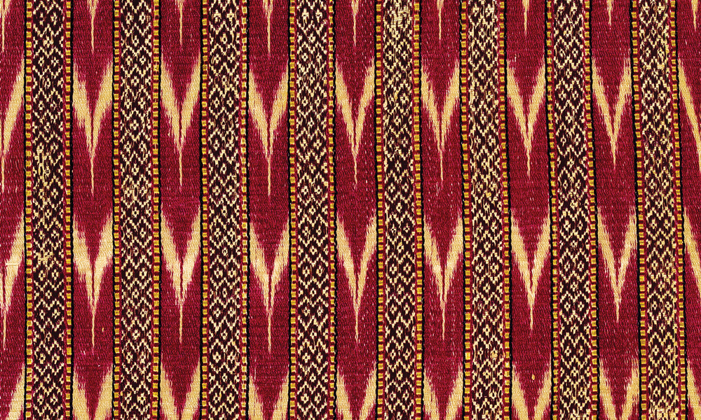 BORNEO  Iban Dayak Pua Kumbu ritual cloth (detail), Mujong River, Sarawak, 16th-17th century. Cotton, warp-ikat, natural dyes. Heribert Amann Collection. This warpikat ritual cloth with the complex trophy head (buah rang jukah) pattern, which has been remarkably wellpreserved in Borneo's humid rainforest conditions, has been C-14 dated to between 1550 and 1640 ce, making it one of the earliest known textiles of its kind.