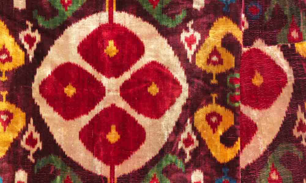 UZBEKISTAN  Bukhara Munisak robe (detail), Central Asia, 3rd quarter 19th century. Silk, seven-colour warpikat velvet (bakhmal) on cotton warps. Los Angeles County Museum of Art, Promised Gift of David and Elizabeth Reisbord, PG.2018.10.1. Called abr in Central Asia, ikats, whether all-silk (atlas) or half-silk (adras), are reliably the world's most brilliantly colourful textiles. Here the warp-ikat technique has been combined with the complex velvet weaving process to produce lengths of fabric for tailoring into the colourful robes worn by both men and women in the Emirate of Bukhara.