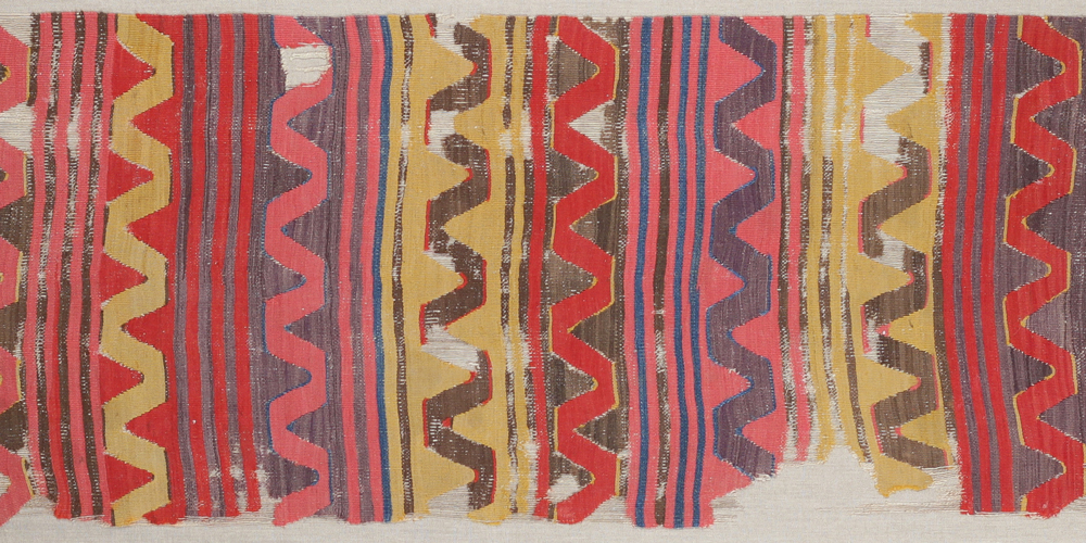"Central Anatolian kilim, before 1800. 0.82 x 3.40 m (2' 8"" x 11' 2"")"