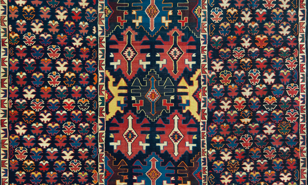 "Shirvan kilim (detail), east Caucasus, 19th century (?). Wool, slit-tapestry weave, 3.11 x 4.86 m (10' 3"" x 15' 0""). Wincor collection 2  Shadda, Karabagh region, southwest Caucasus, early 19th century. Wool with cotton highlights, supplementary weft weave on plainwoven foundation, 1.65 x 2.83 m (5' 5"" x 9' 3"" ). Wincor collection"